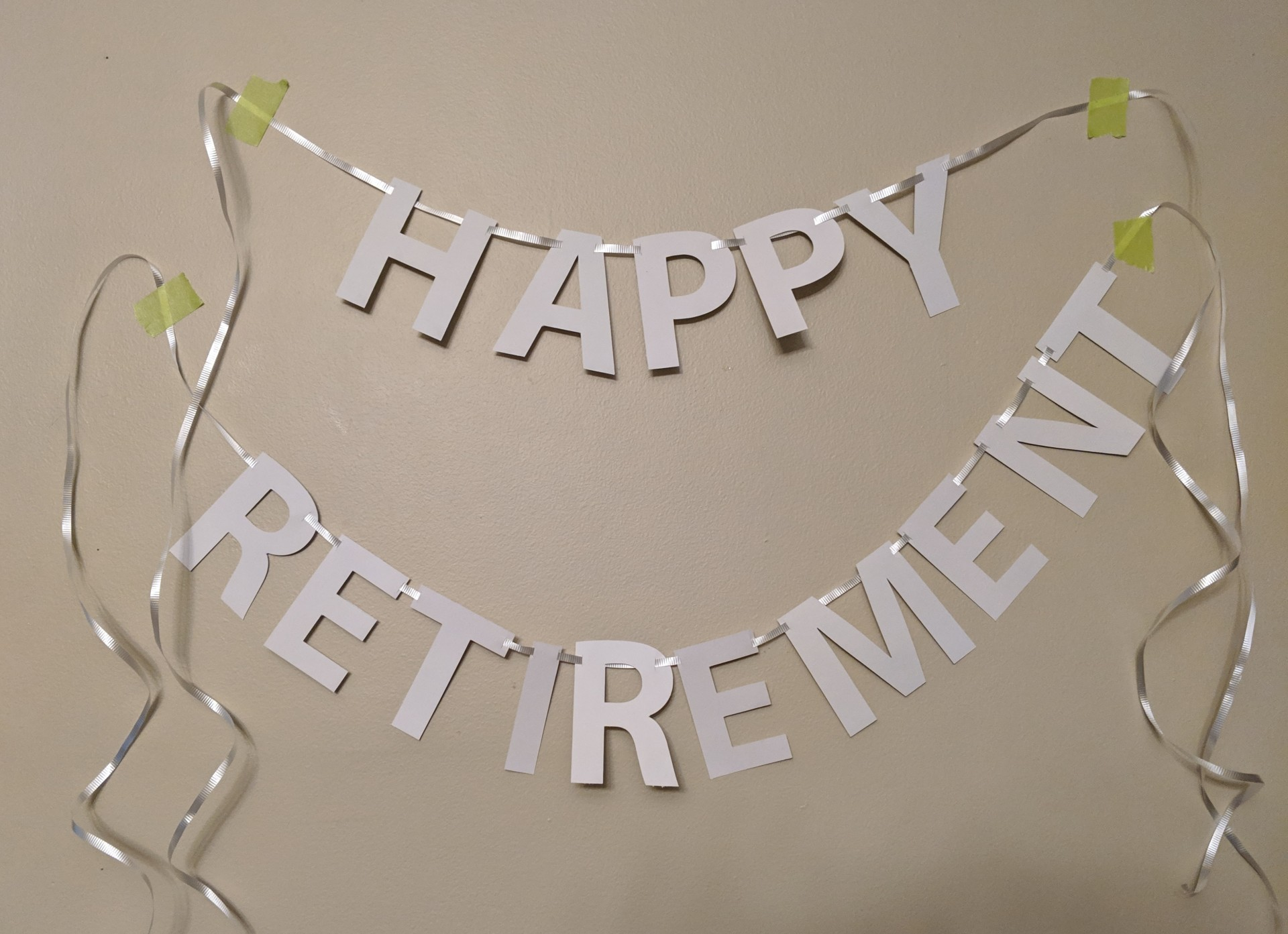 Happy Retirement Grey letters on white ribbon